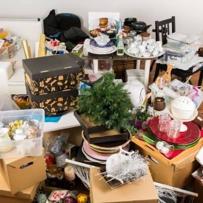 How to determine where to start decluttering. Are you wondering where to start decluttering? Is your house so cluttered you don't know where to begin? Find out the exact process you need to determine where to start decluttering when you're feeling overwhelmed.