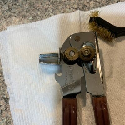 use a wire brush to clean rust off of a can opener